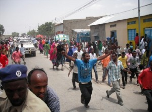 Hero's welcome: young people youths run to see Dr. Samatar