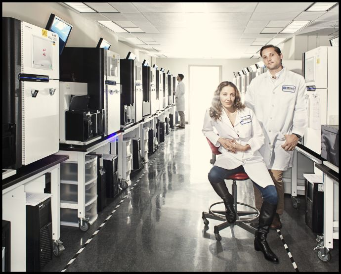 Pardis Sabeti and Stephen Gire in the Genomics Platform of the Broad Institute of M.I.T. and Harvard, in Cambridge, Massachusetts. They have been working to sequence Ebola's genome and track its mutations.Credit Photograph by Dan Winters