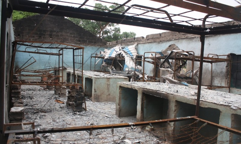 Bare bed frames fill the ruins of the school from which Boko Haram abducted over 200 schoolgirls. (Chika Oduah)