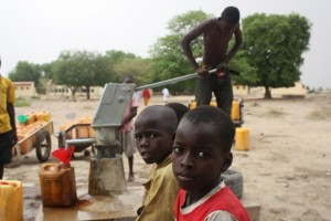 Boys pump water on the campus of the girls' secondary school in Chibok. Photo: Chika Oduah/TAP)