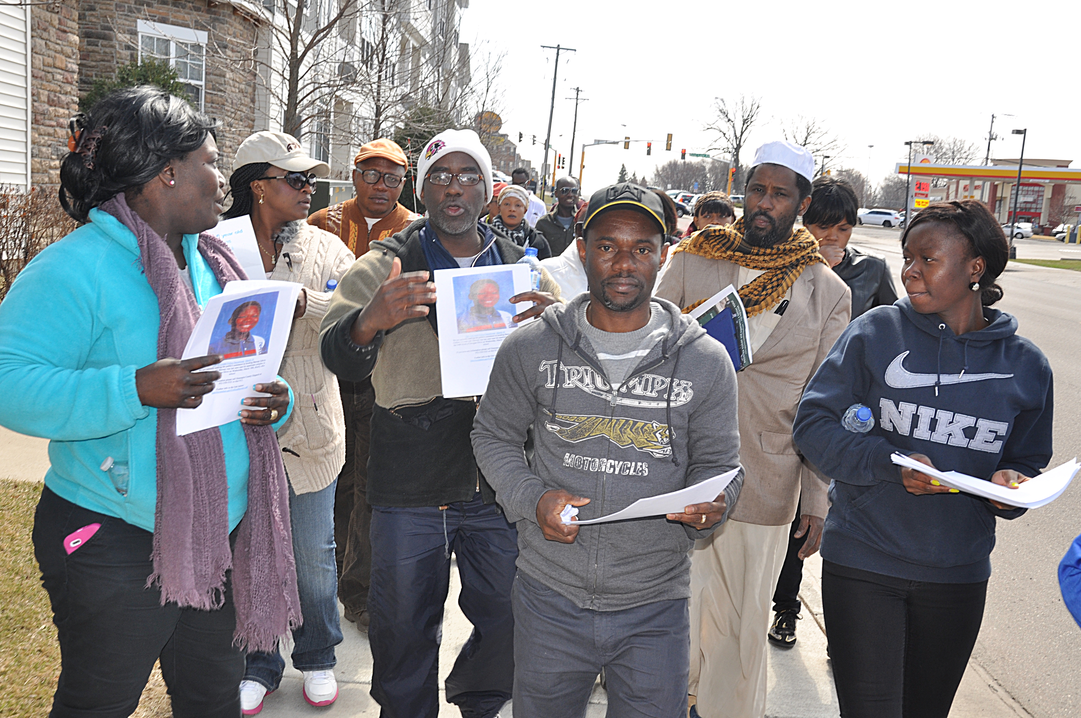 Pierre Collins (center) leads search for missing son. Photo - Issa Mansaray, The AfricaPaper