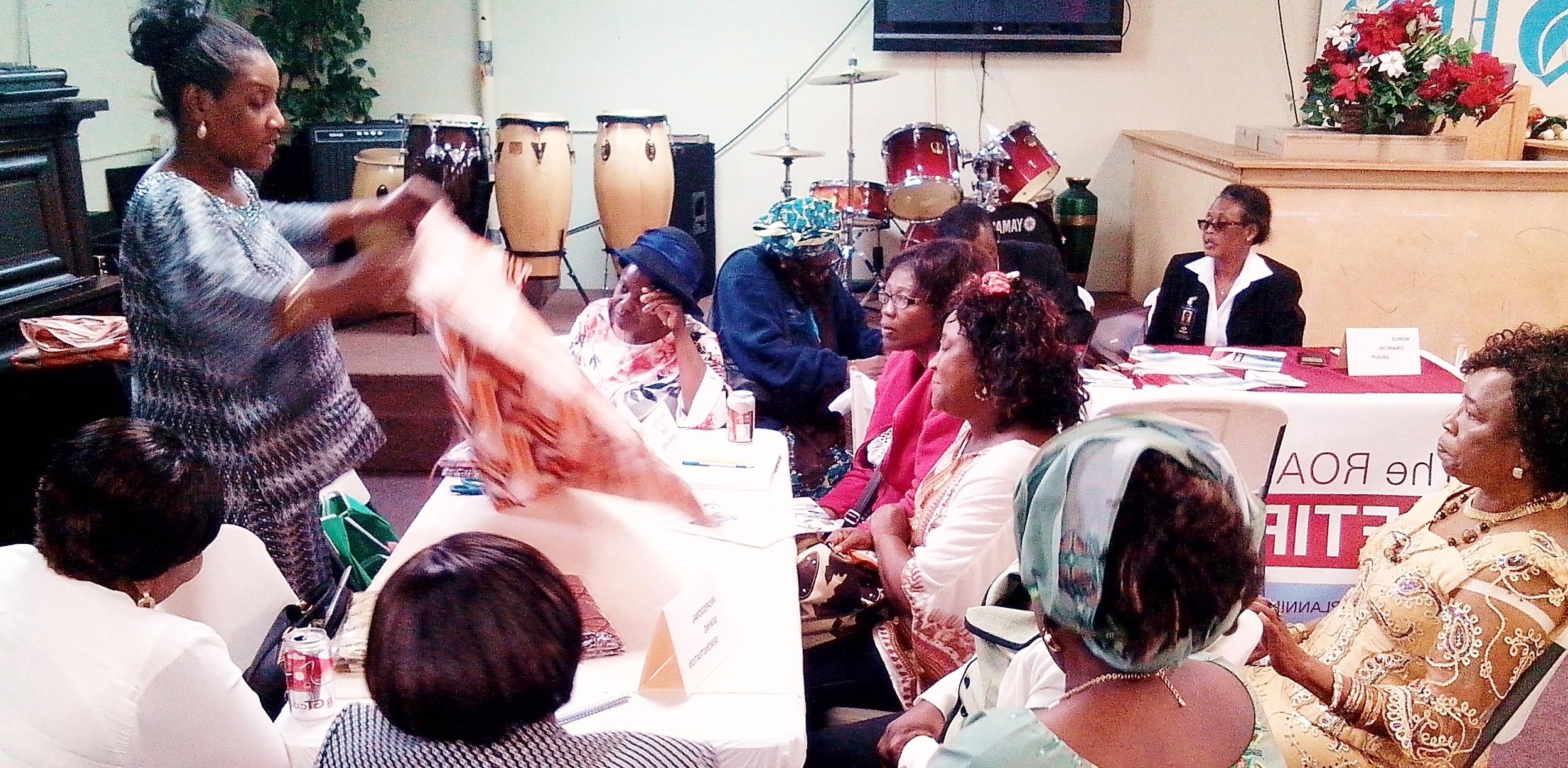 Sis. Kemi Davis (right), demonstrates tailoring techniques during the seminar. Photo: The AfricaPaper/ James Fasuekoi