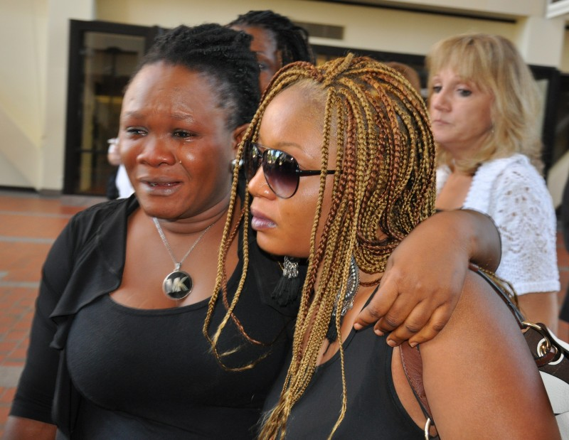 Louise Karluah (l) and Yamah Collins(R) wept in court. Photo: The AfricaPaper/Issa Mansaray