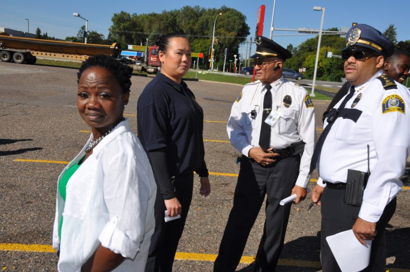 Search volunteer, Magdalene Menyongar (left) and David A. Singleton, Chief Executive Officer of Minnesota Community Policing Services (far right). Photo: (c) The AfricaPaper/Issa A. Mansaray