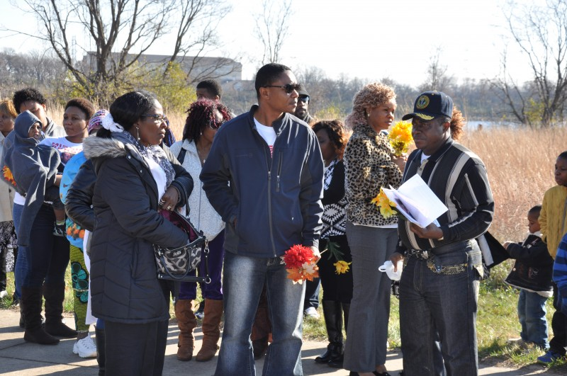 Timothy Borbor (with red flower), McCabe's brother at the vigil. Photo: The AfricaPaper/Issa A. Mansaray