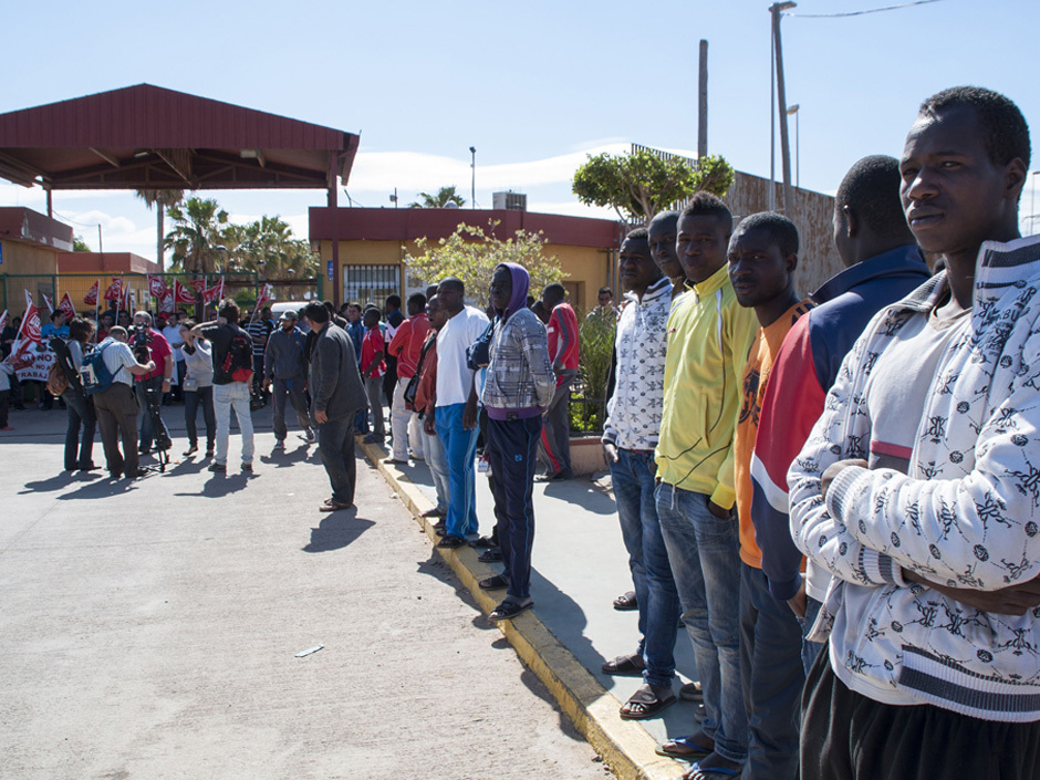 Would-be immigrants stand outside the Centre for Temporary Stay of Immigrants (CETI), following a morning assault in Melilla, on May 28, 2014. About 500 African migrants leapt a towering, triple-layer border fence to cross from Morocco to the tiny Spanish territory of Melilla today, one of the biggest breaches in nearly a decade, officials said. AFP PHOTO/ JESUS BLASQUEZJESUS BLASQUEZ/AFP/Getty Images