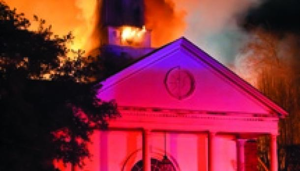 Tyler's First Church of Christ, Scientist in flames.