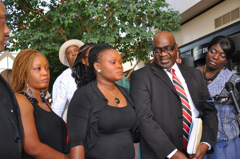 Karluah and her lawyer, Marcus Jarvis talk to the press. Photo: TheAfricaPaper/Issa Mansaray