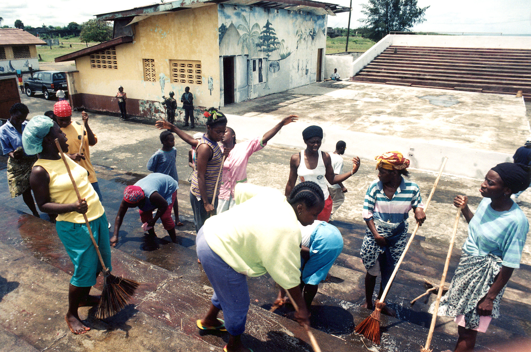 Cleaning the Cultural Center after the war. Photo: The AfricaPaper/ James Fasuekoi
