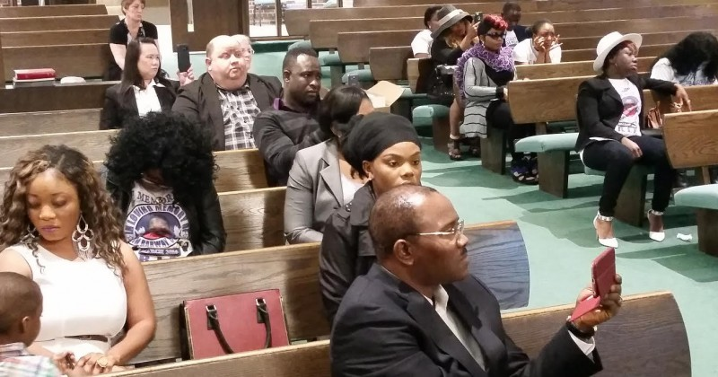 A view of the audience. Sitting second roll in left corner is Yamah Collins, stepmother of Barway Collins. Photo: The AfricaPaper/James Fasuekoi