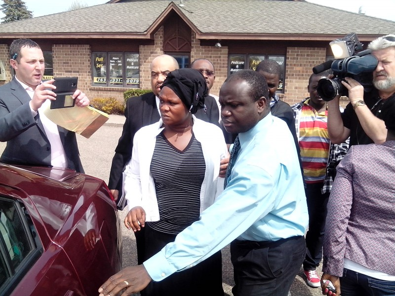 News crew follows Louise Karluah a day after she first arrived in Minnesota for her son's funeral in 2015. Photo: The AfricaPaper/James Fasuekoi