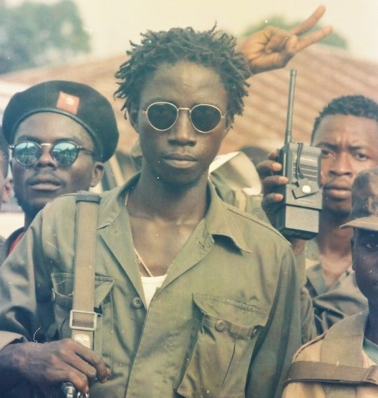 In this 1992 filed photograph across the Po River Bridge, near Combat Camp, ULIMO rebel fighters showed off a heavy weaponry they captured from Taylor's NPFL forces during the battle over Tubmanburg in western Liberia. Photo: James K. Fasuekoi/The AfricaPaper