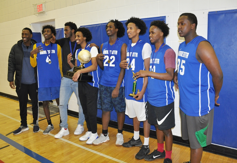 Rev. Jesse Jackson, Sr. gives trophy to winners - St. Paul. Photo: Issa Mansaray/The AfricaPaper