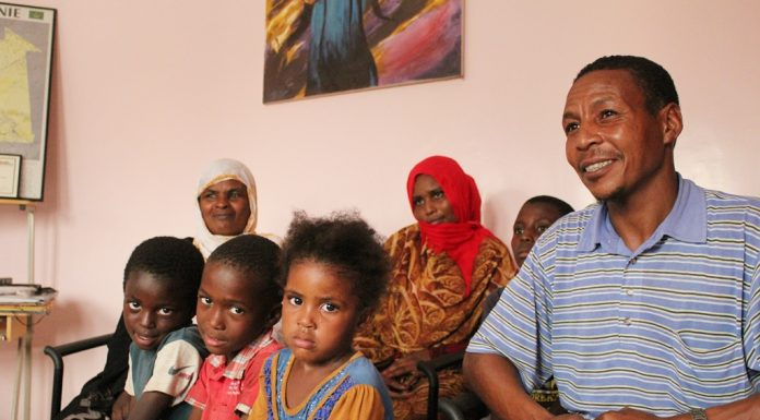 Mataala (far right) and his sister Choueida (far left) with her children in the offices of SOS Esclaves in Nouakchott. All of the family have escaped from slavery. Photo: Michael Hylton/MRG
