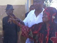 Dr. Samura Kamara and mother after voting in his village, Kamalo. Photo Abubakarr Kamara/The AfricaPaper
