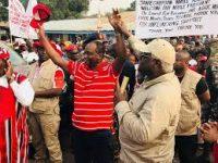 Samura Kamara in red. Photo: Abubakarr Kamara/The AfricaPaper