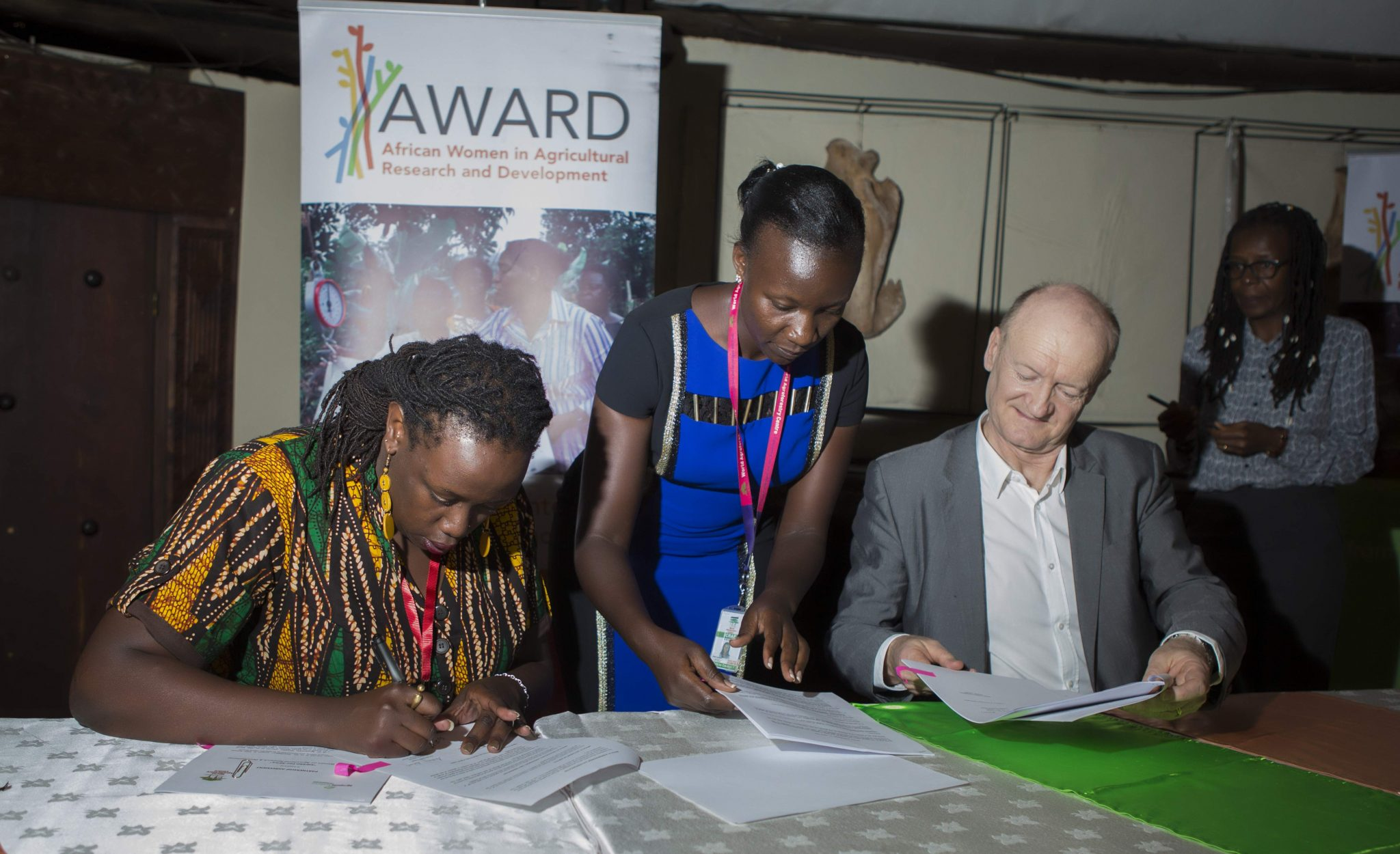Dr.  Wanjiru Kamau-Rutenberg, Director of the Award Fellowships with Dr. Pascal Kosuth, Director, Agropolis Foundation signs the agreement document. Photo: Henry Owino/The AfricaPaper