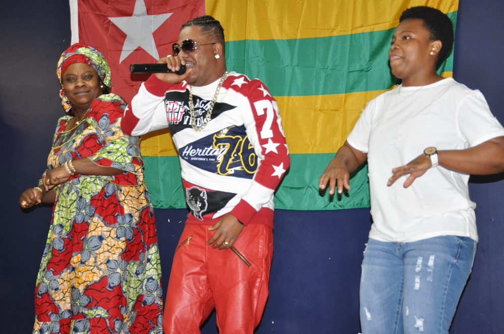 Ali-Jezz (center) takes to the stage. Photo: Issa Mansaray/The AfricaPaper