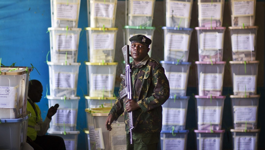 Police guarding ballot boxes after voting exercise