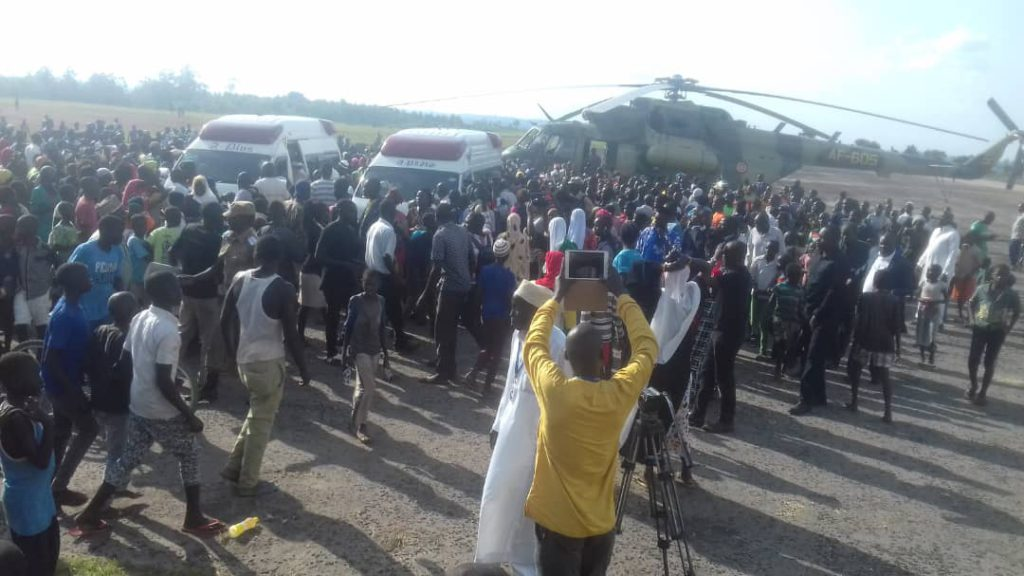 Citizens at airstrip to welcome body of slain Abiriga as situation normalizes through military intervention. Photo: Henry Owino/ The AfricaPaper
