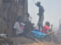 Workers in a waste dump in Freetown, Sierra Leone. Photo: The AfricaPaper/Issa Mansaray